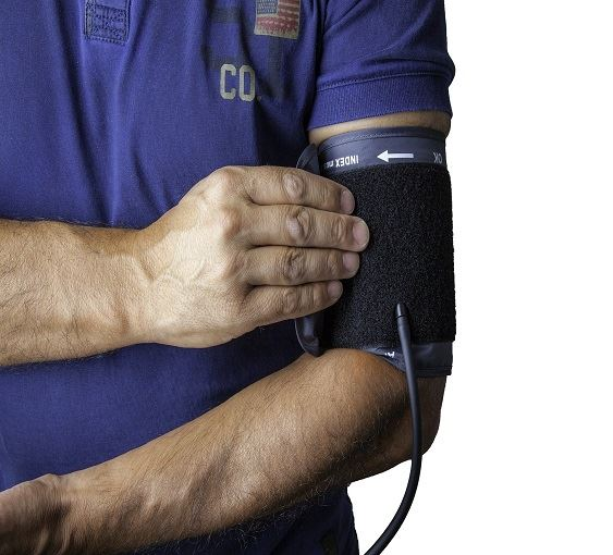 Man uses blood pressure cuff.